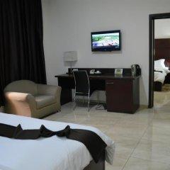 De Santos Hotel удобства в номере