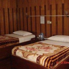 Nanda Wunn Hotel - Hostel комната для гостей фото 3