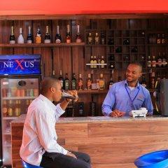 Отель Beneville Hotel and Apartment Нигерия, Калабар - отзывы, цены и фото номеров - забронировать отель Beneville Hotel and Apartment онлайн гостиничный бар