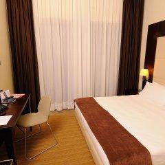 Отель Ih Hotels Milano Watt 13 Милан комната для гостей
