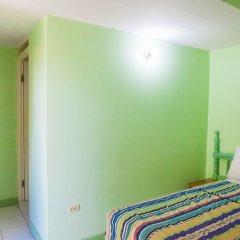 Отель Caribic House Hotel Ямайка, Монтего-Бей - отзывы, цены и фото номеров - забронировать отель Caribic House Hotel онлайн комната для гостей фото 2