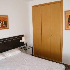 Отель Apartamentos Milenio сейф в номере