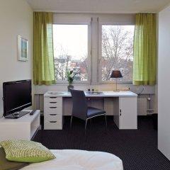 Отель Primestay Apartmenthaus Zurich Seebach Швейцария, Цюрих - отзывы, цены и фото номеров - забронировать отель Primestay Apartmenthaus Zurich Seebach онлайн удобства в номере