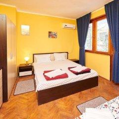 Апартаменты Todorov Apartments Поморие комната для гостей фото 2
