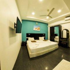 Отель Seven Corals сейф в номере