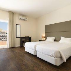 Отель Apartamentos Clube Vilarosa Португалия, Портимао - отзывы, цены и фото номеров - забронировать отель Apartamentos Clube Vilarosa онлайн комната для гостей фото 4