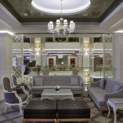 Queens Park Resort Турция, Кемер - отзывы, цены и фото номеров - забронировать отель Queens Park Resort онлайн интерьер отеля фото 2
