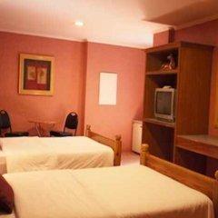 Отель Nichols Airport Hotel Филиппины, Паранак - отзывы, цены и фото номеров - забронировать отель Nichols Airport Hotel онлайн сейф в номере