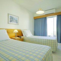 Отель TURIM Algarve Mor Hotel Португалия, Портимао - отзывы, цены и фото номеров - забронировать отель TURIM Algarve Mor Hotel онлайн комната для гостей фото 4