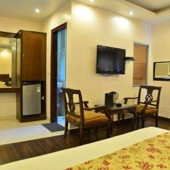 Отель Amax Inn Индия, Нью-Дели - отзывы, цены и фото номеров - забронировать отель Amax Inn онлайн удобства в номере фото 2