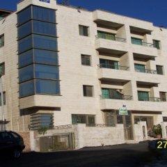 Отель Askadenya Apartments Иордания, Амман - отзывы, цены и фото номеров - забронировать отель Askadenya Apartments онлайн вид на фасад фото 2