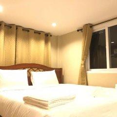 Апартаменты AN Apartment Паттайя комната для гостей