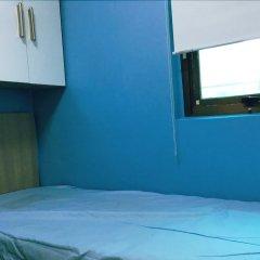 Отель Feel House сейф в номере