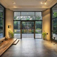 Апартаменты Orange Grove Service Apartment by ST Residences фитнесс-зал фото 4