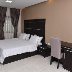 Отель Urban Metro Inn сейф в номере