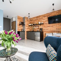 Апартаменты Roztocka Loft Apartment Варшава комната для гостей фото 3