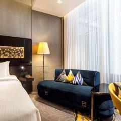 Отель Novotel Singapore on Stevens комната для гостей фото 3