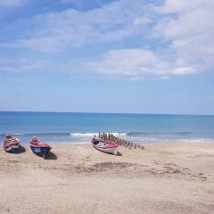 Отель Sandune Cottage Треже-Бич пляж
