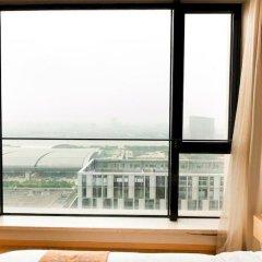 Отель Yishang Baoli Shimao International Apartment Китай, Гуанчжоу - отзывы, цены и фото номеров - забронировать отель Yishang Baoli Shimao International Apartment онлайн балкон
