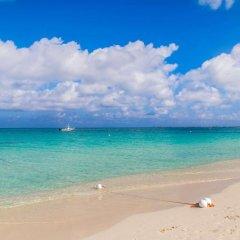 Отель Comfort Suites Seven Mile Beach Каймановы острова, Севен-Майл-Бич - отзывы, цены и фото номеров - забронировать отель Comfort Suites Seven Mile Beach онлайн пляж фото 2