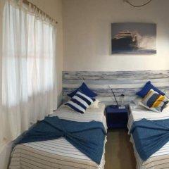 Отель Thulusdhoo Surf Camp Остров Гасфинолу комната для гостей фото 3