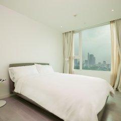 Отель M Suites by S Home Хошимин комната для гостей фото 4