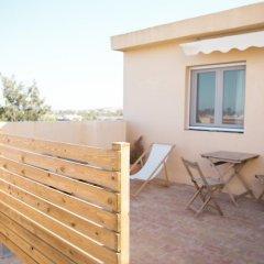 Отель Nexo Surf House Испания, Вехер-де-ла-Фронтера - отзывы, цены и фото номеров - забронировать отель Nexo Surf House онлайн балкон