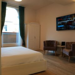 Отель Cosmopolitan Central Rooms Италия, Болонья - отзывы, цены и фото номеров - забронировать отель Cosmopolitan Central Rooms онлайн комната для гостей
