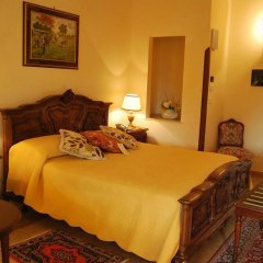 Отель Sangiorgio Resort & Spa Кутрофьяно комната для гостей фото 3