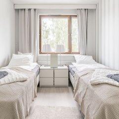 Апартаменты Local Nordic Apartments - Polar Bear Ювяскюля комната для гостей фото 3