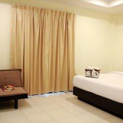 Отель Nirvana Inn сейф в номере