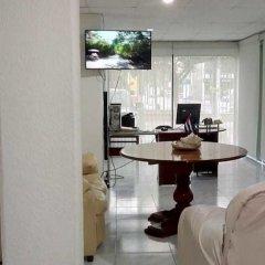 Отель Ikaro Suites Cancun Мексика, Канкун - отзывы, цены и фото номеров - забронировать отель Ikaro Suites Cancun онлайн интерьер отеля фото 4