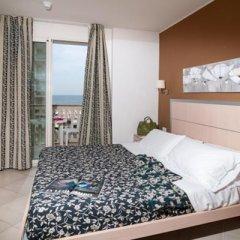 Отель Residence T2 Италия, Римини - 2 отзыва об отеле, цены и фото номеров - забронировать отель Residence T2 онлайн комната для гостей фото 5
