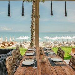Отель Blue Carpet Luxury Suites Греция, Ханиотис - отзывы, цены и фото номеров - забронировать отель Blue Carpet Luxury Suites онлайн пляж фото 2