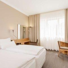 Отель NH München Messe Германия, Мюнхен - 2 отзыва об отеле, цены и фото номеров - забронировать отель NH München Messe онлайн комната для гостей