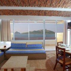 Отель Las Flores Beach Resort в номере фото 2