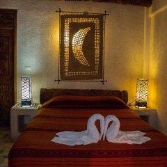 Отель Villas Las Azucenas Мексика, Сиуатанехо - отзывы, цены и фото номеров - забронировать отель Villas Las Azucenas онлайн комната для гостей фото 2
