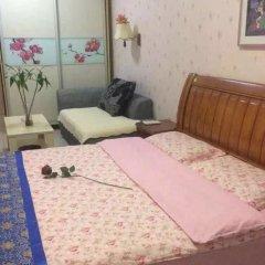 Отель Dihao Holiday Apartment Hotel Китай, Сиань - отзывы, цены и фото номеров - забронировать отель Dihao Holiday Apartment Hotel онлайн комната для гостей фото 2
