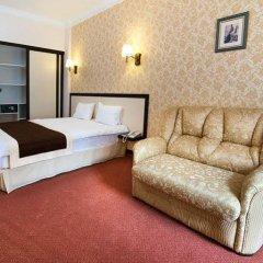 Corona Hotel & Apartments комната для гостей