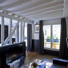 Отель Les Suites Parisiennes Франция, Париж - отзывы, цены и фото номеров - забронировать отель Les Suites Parisiennes онлайн комната для гостей