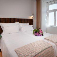 Отель Ouro Grand By Level Residences Лиссабон комната для гостей