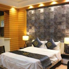 Апартаменты She & He Service Apartment - Huifeng комната для гостей
