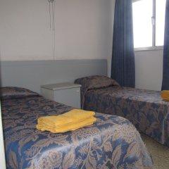 Апартаменты Shamrock Apartments Каура комната для гостей