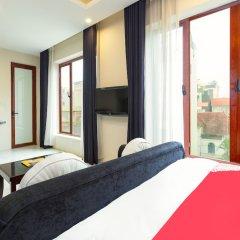 OYO 779 Aisha Hotel And Apartment Ханой комната для гостей