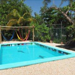 Отель Hostel Punta Sam Мексика, Плайя-Мухерес - отзывы, цены и фото номеров - забронировать отель Hostel Punta Sam онлайн бассейн