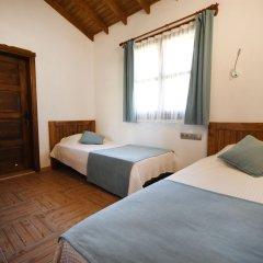 KAY6700 Villa Malhun 2 Bedrooms Турция, Кесилер - отзывы, цены и фото номеров - забронировать отель KAY6700 Villa Malhun 2 Bedrooms онлайн комната для гостей фото 2