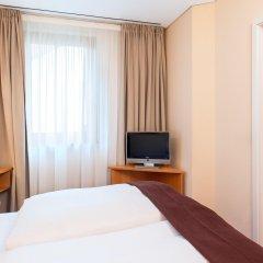 Отель NH München Unterhaching Германия, Унтерхахинг - 1 отзыв об отеле, цены и фото номеров - забронировать отель NH München Unterhaching онлайн удобства в номере фото 2