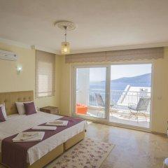Villa Baysal 5 by Akdenizvillam Турция, Патара - отзывы, цены и фото номеров - забронировать отель Villa Baysal 5 by Akdenizvillam онлайн комната для гостей фото 4