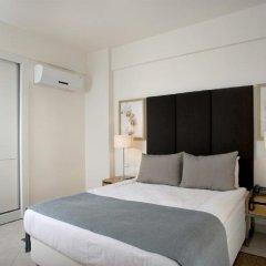 Апартаменты Kusadasi Golf and Spa Apartments Сельчук комната для гостей