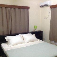 Отель Holiday Lodge Сьерра-Леоне, Фритаун - отзывы, цены и фото номеров - забронировать отель Holiday Lodge онлайн комната для гостей фото 5